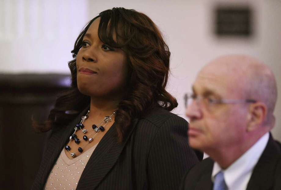 Dunbar Elementary School Principal Marilyn Taylor with her attorney Edward W. Vioni during Taylor's arraignment at the Connecticut Superior Court in Bridgeport, Conn. Friday, Jan. 2, 2015.  Taylor is being charged with first-degree larceny and police said Taylor began tapping into a school fundraising account in November 2013, making 24 cash withdrawals from the account at the Mohegan Sun Casino totaling $10,021.40. Photo: Tyler Sizemore / Greenwich Time