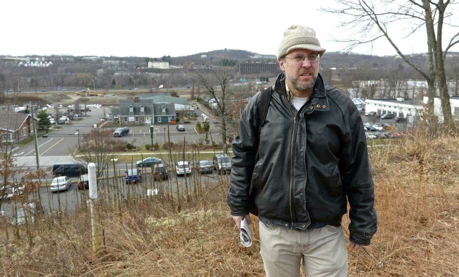 James Root, 49, a Danbury resident, who has concerns about the expansion of the  Algonquin natural gas pipeline that runs through Danbury, Conn. Root stands on a hill,  on Friday, January 2, 2015, overlooking Mill Plain Road, the Still River,  I-84, and the present route of the Algonquin pipeline that will be enlarged as part of a four-state project. Photo: H John Voorhees III / The News-Times
