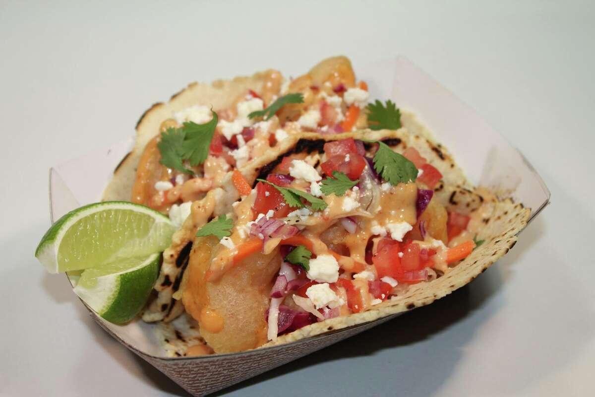 Tempura shrimp tacos at Scratch Bistro. Tempura fried shrimp tacos with pico, vinegar slaw, cojita, chipotle remoulade and cilantro.