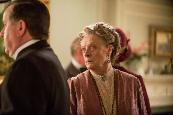 Maggie Smith as Violet, Dowager Countess of Grantham, delivers the most entertaining lines in 'Downton Abbey,' Season 5 on PBS. January, 2015 Downton Abbey, Season 5 MASTERPIECE on PBS Sundays, January 4 - March 1, 2015 at 9pm ET  Episode 1  Shown: Maggie Smith as Violet, Dowager Countess of Grantham  (C) Nick Briggs/Carnival Film & Television Limited 2014 for MASTERPIECE  This image may be used only in the direct promotion of MASTERPIECE CLASSIC. No other rights are granted. All rights are reserved. Editorial use only. USE ON THIRD PARTY SITES SUCH AS FACEBOOK AND TWITTER IS NOT ALLOWED.