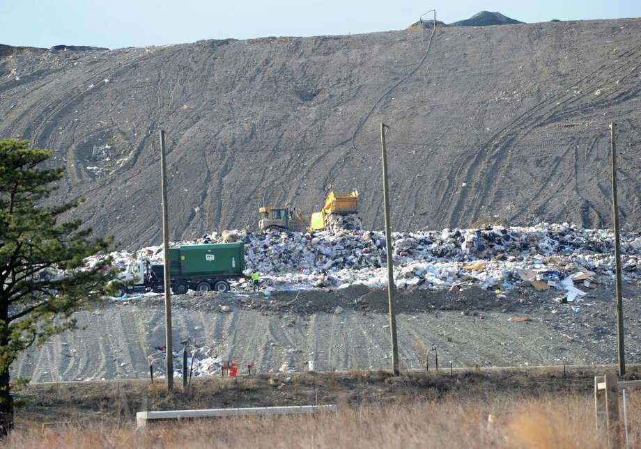 Trucks and tractors are seen at the Albany Solid Waste Management Facility on Friday, Jan. 2, 2015 in Albany, N.Y. City landfill managers have removed the authority of the facility?s scale operator to void and delete transactions after an audit found ?significant opportunities? for abuse. (Lori Van Buren / Times Union) Photo: Lori Van Buren