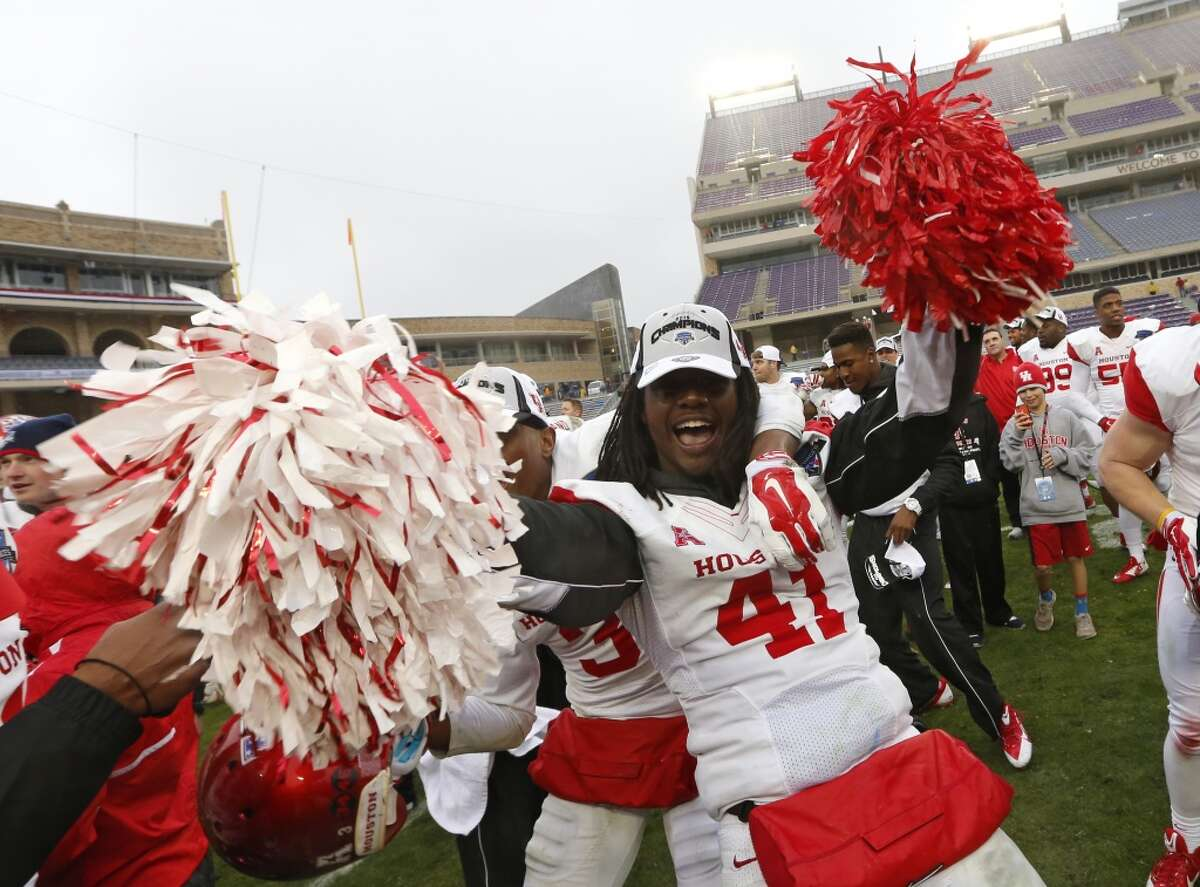 Jan. 2: Houston 35, Pitt 34 Record: 8-5 Houston linebacker Steven Taylor (41) celebrates while singing the school song and holding pom poms after they defeated Pittsburgh 35-34 in the Armed Forces Bowl.