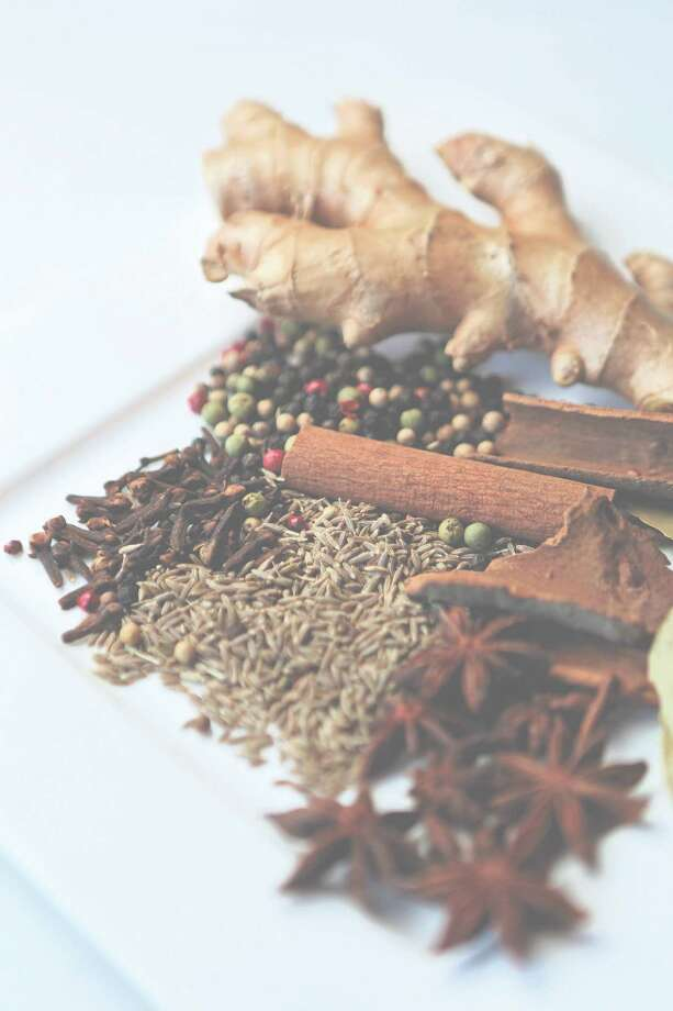 Spices added to your food can help reduce blood-fat triglycerides. Photo: Mayra Beltran, Staff / Â 2014 Houston Chronicle