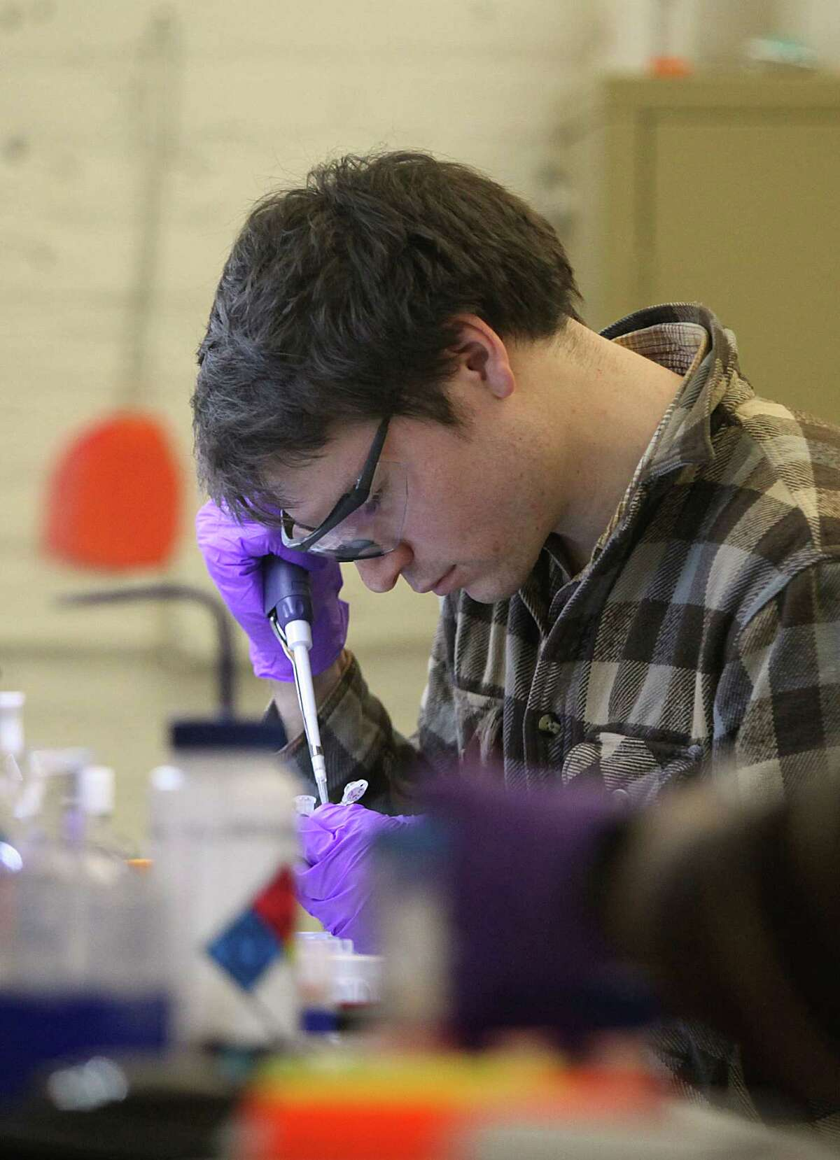 Scientist Sean Hacking prepares emulsion at Cambrian Genomics in San Francisco on Dec. 11.