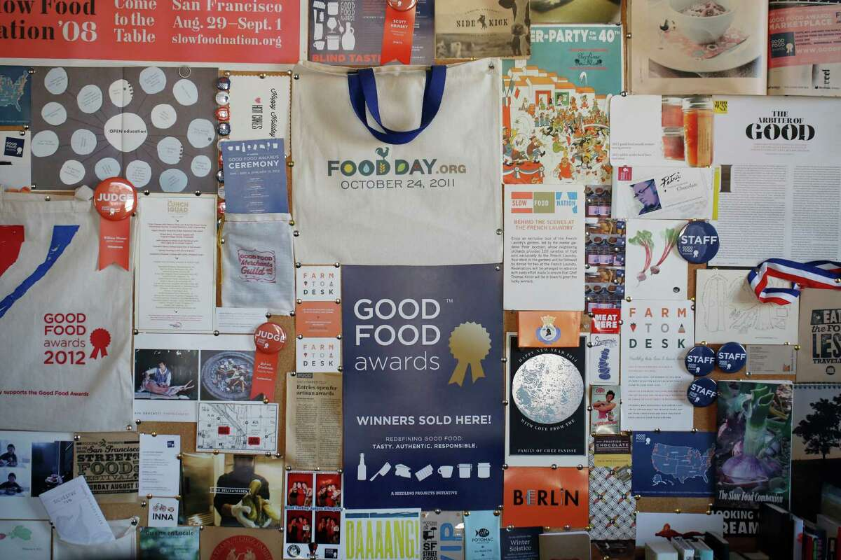 The back wall of the Good Food Awards office Fort Mason is plastered with past successes on Tuesday Dec. 23, 2014 in San Francisco, Calif.