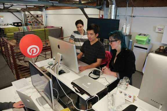 Engineers at work in the offices of Pinterest in San Francisco. The company received $200 million in a funding round last year.