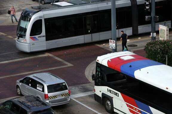 Riders arrive to the Downtown Transit Center, and people will be able to use purchased train ticket and use the same ticket when transferring to a Metro bus. ( Mayra Beltran / Houston Chronicle )