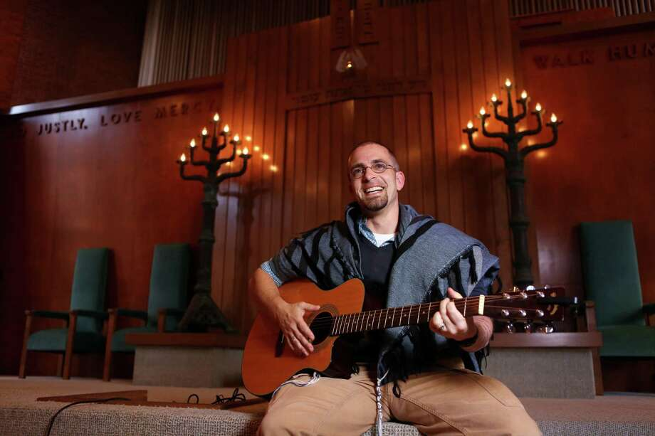 Rabbi Marshal Klaven plays guitar inside the sanctuary at Temple B'Nai Israel. Temple B'Nai Israel is his new permanent assignment. Photo: Mayra Beltran, Staff / © 2014 Houston Chronicle