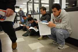 Armando Ramos studies for his drivers test at the DMV on Friday, January 2, 2014 in San Jose, Calif. The DMV is allowing undocumented immigrants to obtain driver's licenses under AB 60.