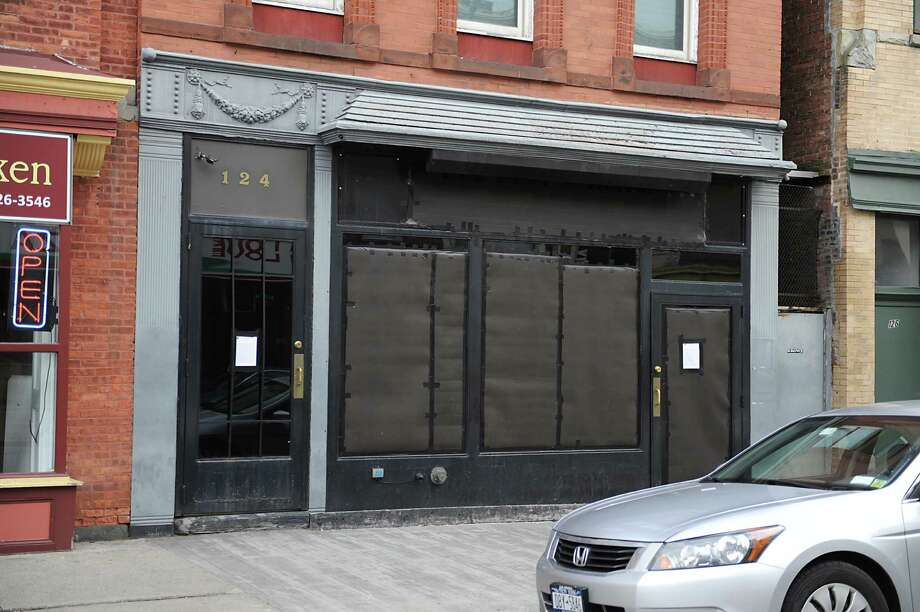 The doors and windows of Kokopellis night club on 4th St. are seen boarded up on Friday, Jan. 2, 2015 in Troy, N.Y. The owners have decided to close the establishment because of an incident involving the police in January of 2014.  (Lori Van Buren / Times Union) Photo: Lori Van Buren