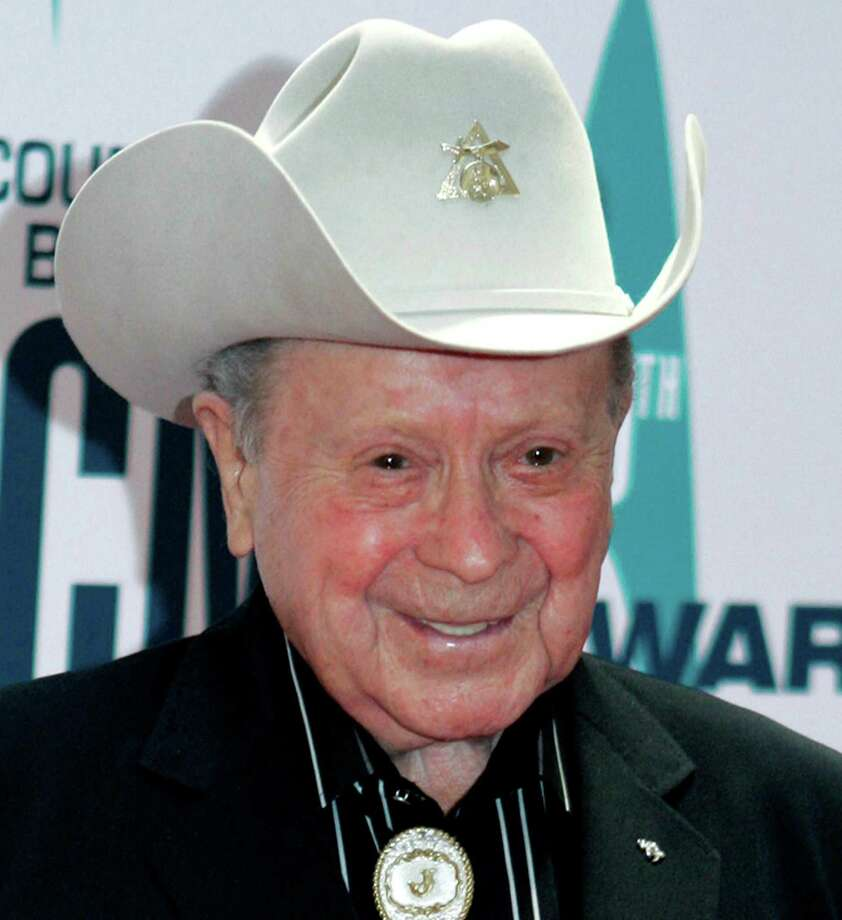 "FILE - In this Nov. 6, 2006 file photo, Grand Ole Opry star Little Jimmy Dickens arrives at the 40th Annual CMA Awards in Nashville, Tenn. Dickens has been hospitalized with an undisclosed illness. Jessie Schmidt, a publicist for the Opry, said in a news release Sunday, Dec. 28, 2014, that Dickens was admitted to a Nashville-area hospital on Dec. 25 and that he's in ""critical care."" (AP Photo/Chitose Suzuki, File) ORG XMIT: NY120 Photo: Chitose Suzuki / AP"