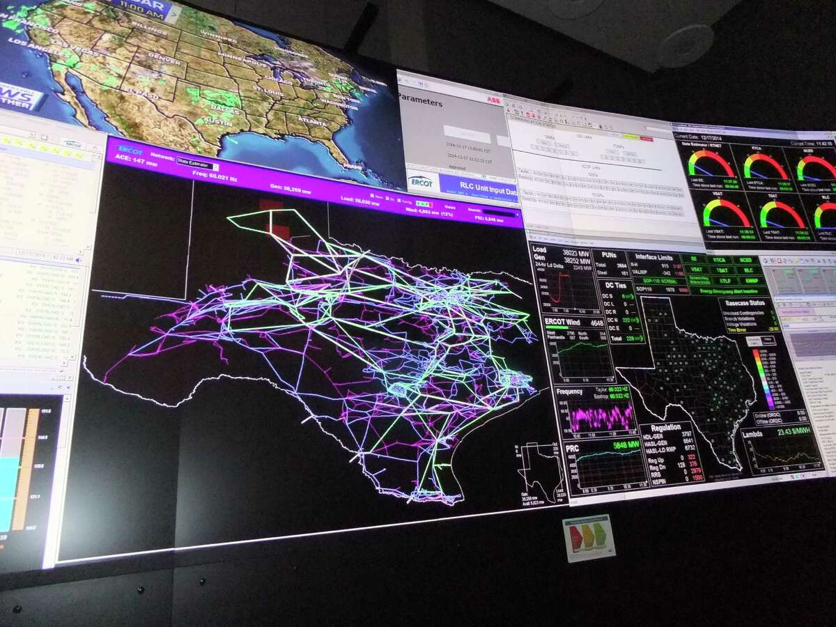 A map of Texas showing the state's transmission lines is a focal point in the ERCOT control room.
