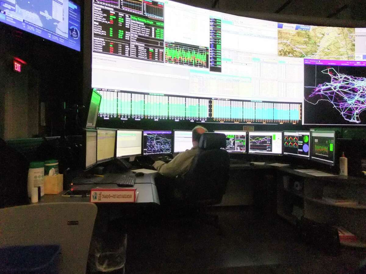 Banks of desk and wall monitors display the status of the state's power grid in the control room of the Electric Reliability Council of Texas, which operates most of the grid.