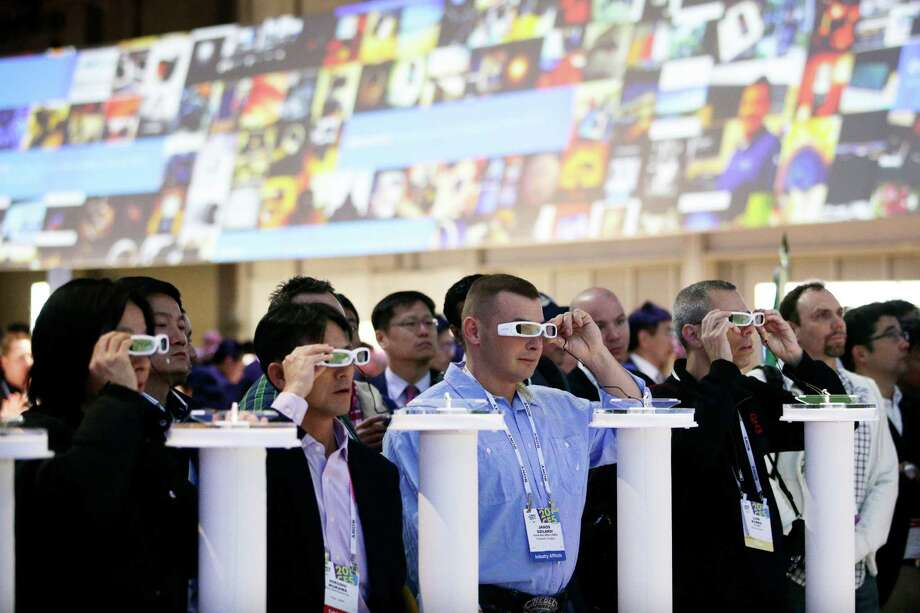 People try out the Sony Smart Eyeglass prototypes at last year's International Consumer Electronics Show. Photo: Jae C. Hong / Associated Press / AP