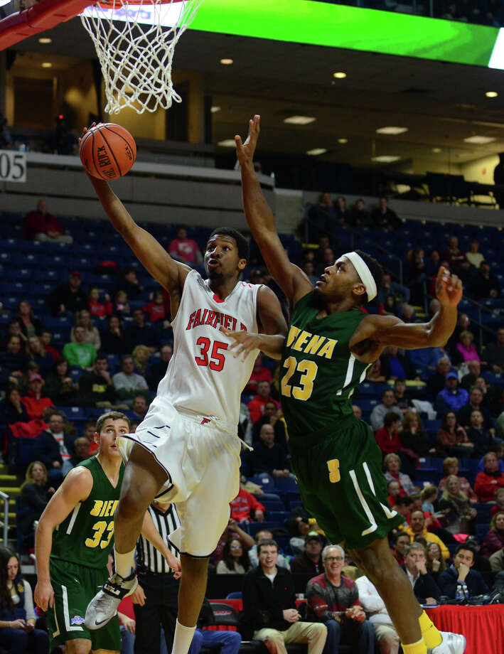 Fairfield University's Coleman Johnson lays up for two points as Siena College's Maurice White defends, during men's basketball action at the Webster Bank Arena in Bridgeport, Conn. on Friday Jan. 2, 2015. Photo: Christian Abraham / Connecticut Post