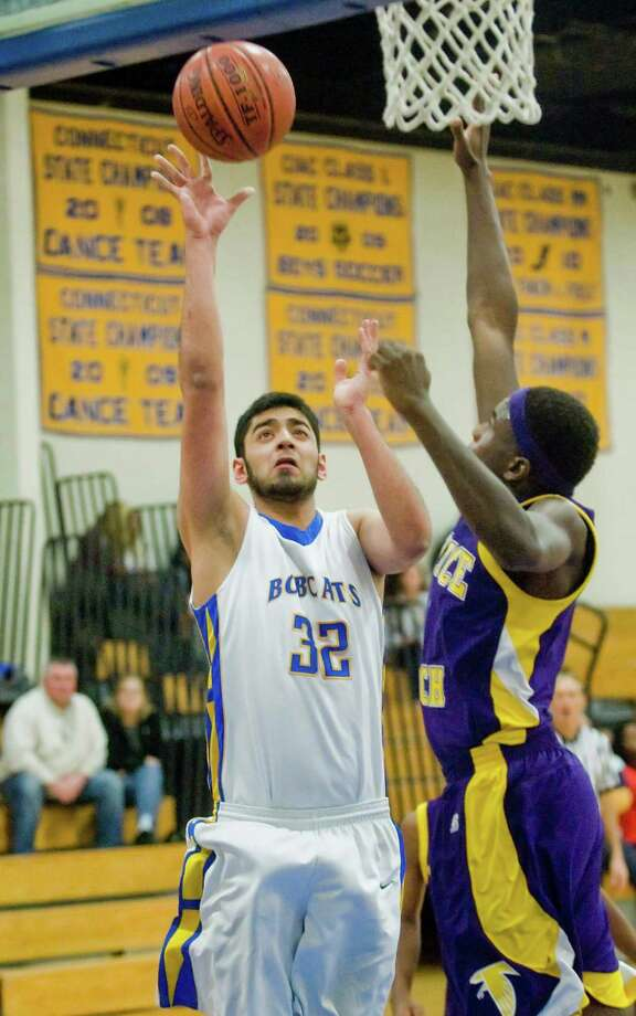 Brookfield High School's Muhammad Sakhi shooting in a game against Prince Tech High School played at Brookfield. Friday Jan. 2, 2015 Photo: Scott Mullin / The News-Times Freelance