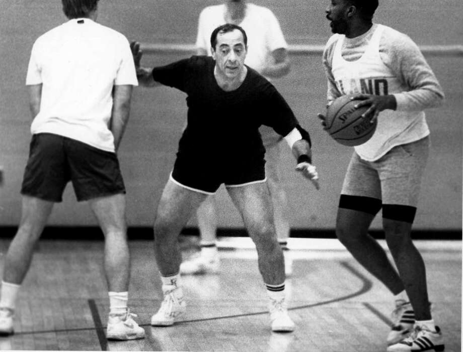 Gov. Mario Cuomo, center, plays defense during one of his weekly basketball games of with staffers Wednesday, Dec. 4, 1991, in Albany, N.Y. (Steve Jacobs/Times Union archive)