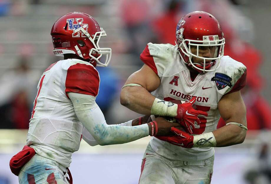 FORT WORTH, TX - JANUARY 02: Greg Ward Jr. #1 of the Houston Cougars hands off to Kenneth Farrow #35 during the Lockheed Martin Armed Forces Bowl game against the Pittsburgh Panthers at Amon G. Carter Stadium on January 2, 2015 in Fort Worth, Texas. Photo: Sarah Glenn, Getty Images / 2015 Getty Images