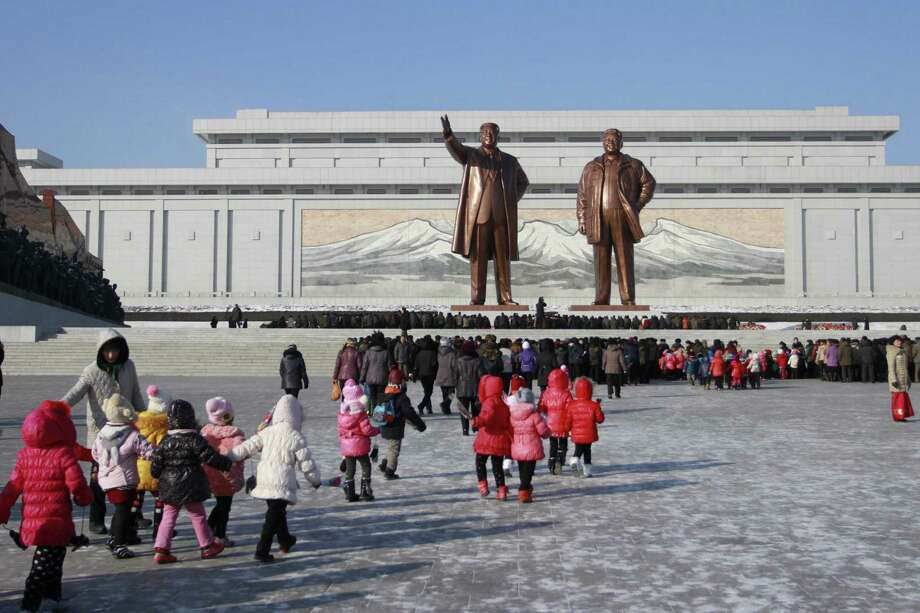FILE - In thus Dec. 16, 2014 file photo, North Koreans gather at the Mansu Hill where the statues of the late leaders Kim Il Sung, and Kim Jong Il tower over them, in Pyongyang, North Korea. The U.S. is imposing sanctions on North Korea in retaliation for the cyberattack against Sony Pictures Entertainment. President Barack Obama signed an executive order on Friday authorizing the sanctions. Although the U.S. has already sanctioned North Korea over its nuclear program, these are the first sanctions punishing Pyongyang for alleged cyberattacks. (AP Photo/Wong Maye-E, File) ORG XMIT: WX103 Photo: Jon Chol Jin / AP