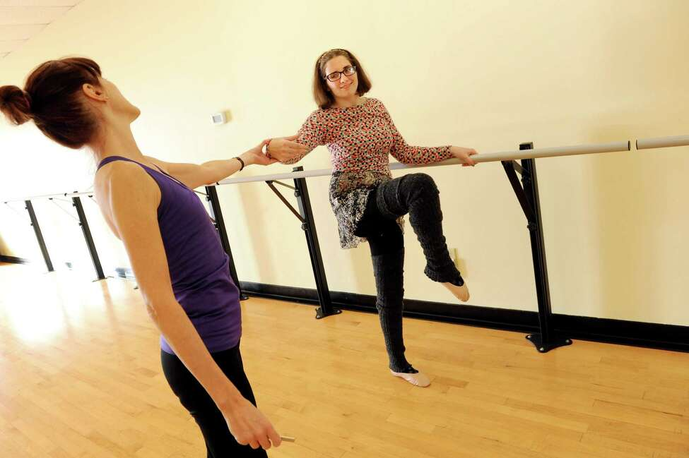 Laura Casellini, 22, of East Greenbush, right, works on her balance during a ballet lesson with Gail Tassarotti on Tuesday, Dec. 30, 2014, at Albany Dance and Fitness in Colonie, N.Y. Casellini suffered a traumatic brain injury after a car accident and dancing is part of her ongoing therapy. (Cindy Schultz / Times Union)