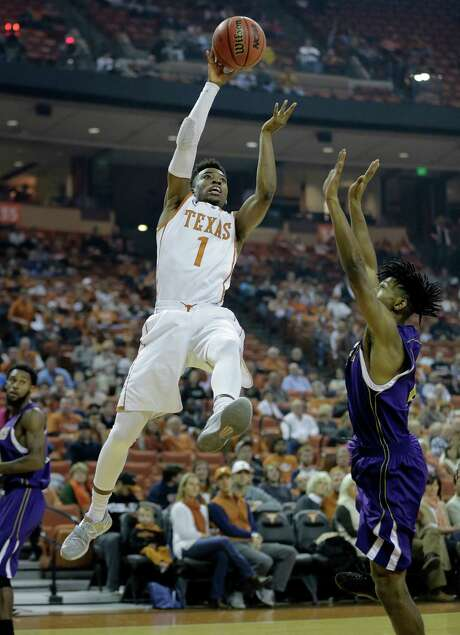 Texas coach Rick Barnes is happy to have Isaiah Taylor (1) back to stop opposing teams from frustrating the Longhorns' backcourt with pressure. Photo: Eric Gay, STF / AP