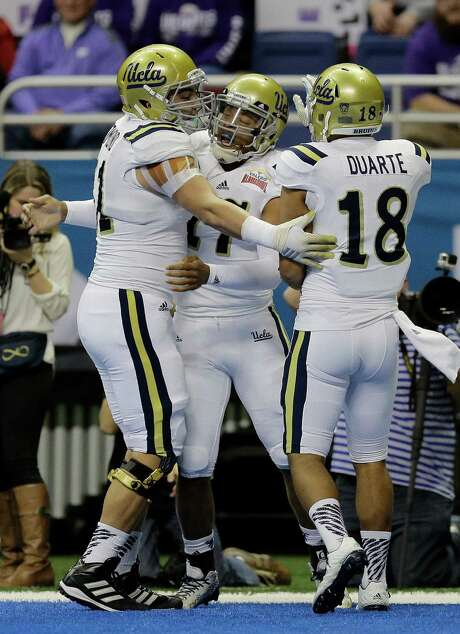 Although Kansas State made it close late in the fourth quarter, most of the celebrating at the Alamo Bowl was done by UCLA quarterback Brett Hundley (17) and the Bruins, who hung on for a 40-35 win. Photo: Eric Gay, STF / AP