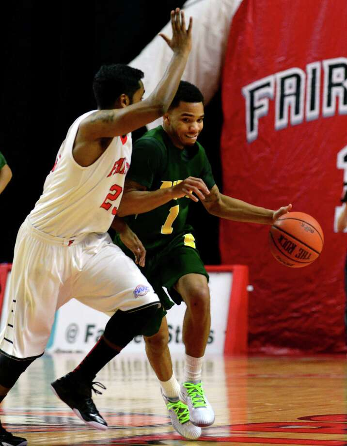 Siena College's Marquis Wright tries to drives the ball past Fairfield University's Steve Johnston, during men's basketball action at the Webster Bank Arena in Bridgeport, Conn. on Friday Jan. 2, 2015. ORG XMIT: 530370 Photo: Christian Abraham / Connecticut Post