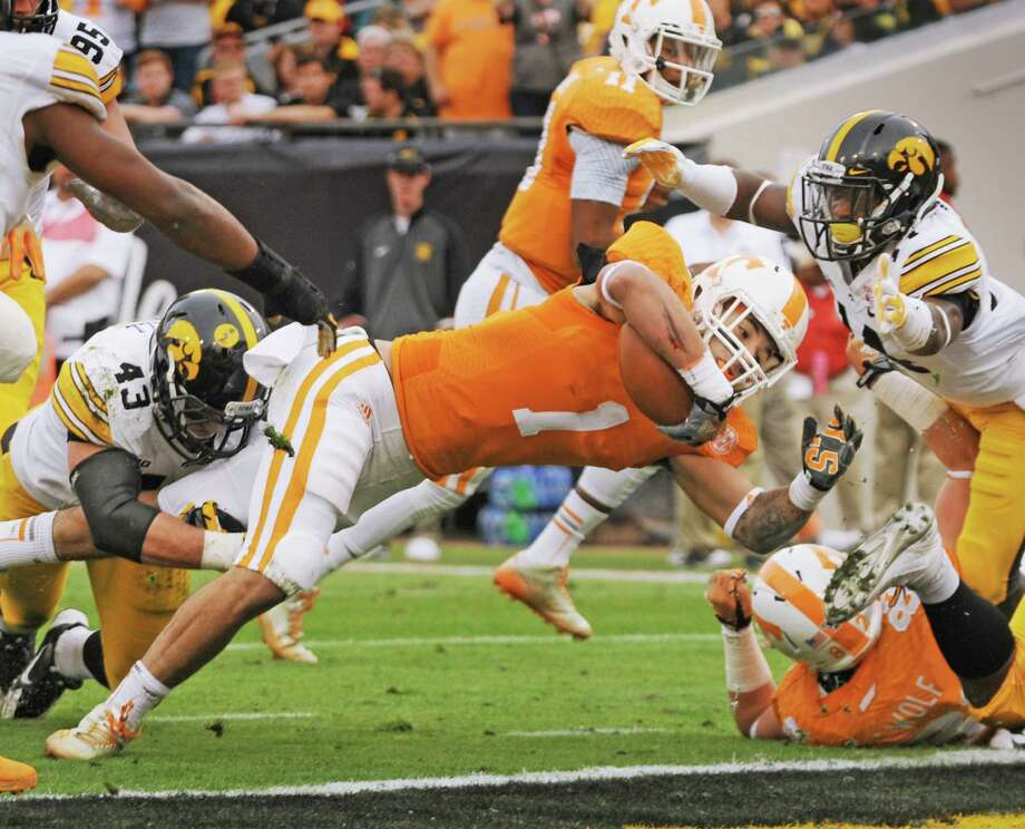 Tennessee's Jalen Hurd dives into the end zone for the Volunteers first touchdown of the game during the first half of the TaxSlayer Bowl NCAA college football game against Iowa, Friday, Jan. 2, 2015, in Jacksonville, Fla. (AP Photo/The Florida Times-Union, Bob Self) ORG XMIT: FLJAJ107 Photo: Bob Self / The Florida Times-Union