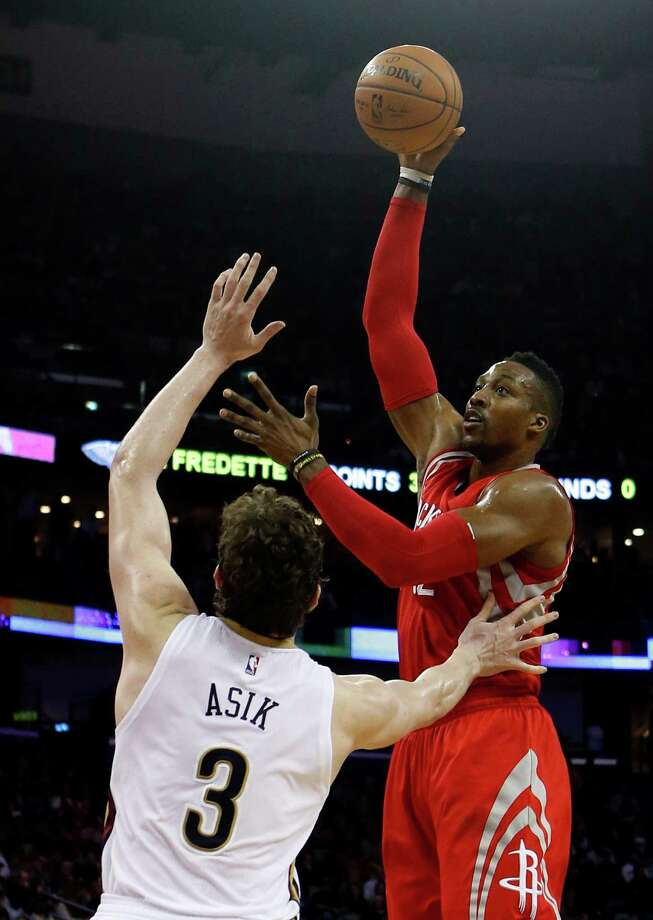 Dwight Howard, right, shoots over former teammate Omer Asik in the first half. Howard wound up with 12 points and Asik had 11 rebounds for the Pelicans. Photo: Butch Dill, FRE / FR111446 AP