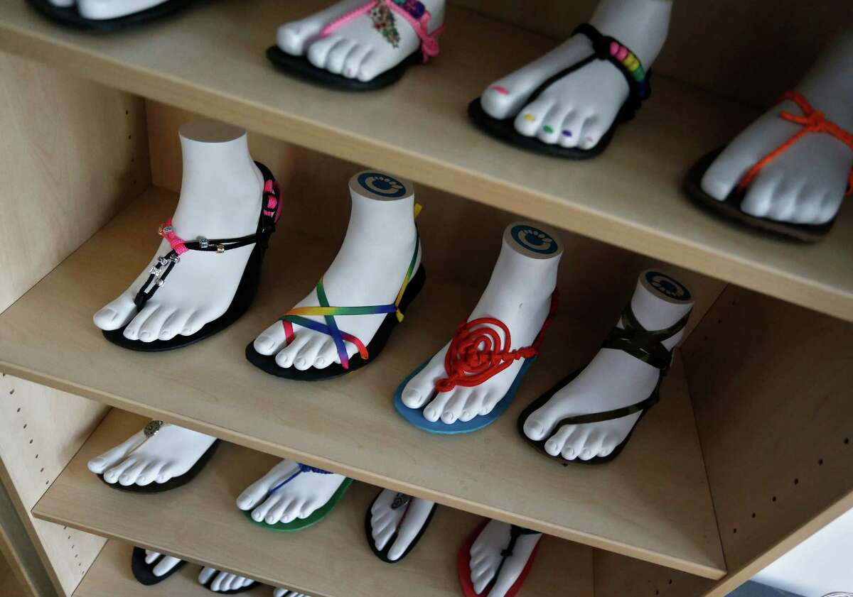 Sandals are on display at Xero Shoes' headquarters in Broomfield, Colo. The company hopes for an easier time getting a Small Business Administration loan in the new year.