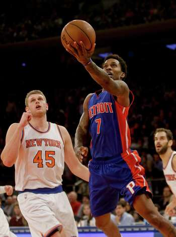 Detroit Pistons' Brandon Jennings (7) drives past New York Knicks' Cole Aldrich (45) during the first half of an NBA basketball game Friday, Jan. 2, 2015, in New York. (AP Photo/Frank Franklin II) ORG XMIT: MSG106 Photo: Frank Franklin II / AP