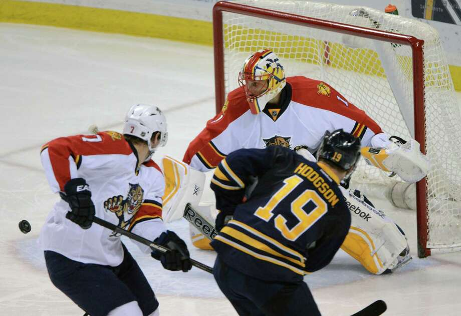 Buffalo Sabres center Cody Hodgson (19) watches his rebound as Florida Panthers defenseman Dmitry Kulikov (7) and goaltender Roberto Luongo (1) defend during the third period of an NHL hockey game Friday, Jan. 2, 2015, in Buffalo, N.Y.  Florida won 2-0. (AP Photo/Gary Wiepert) ORG XMIT: NYGW109 Photo: Gary Wiepert / FR170498 AP