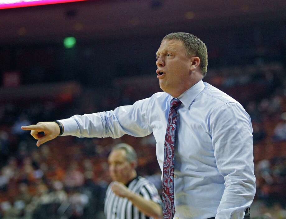 Rice head coach Mike Rhoades calls out to his team during an NCAA college basketball game against Texas, Monday, Dec. 29, 2014, in Austin, Texas. (AP Photo/Michael Thomas) Photo: Michael Thomas, Associated Press / FR65778 AP