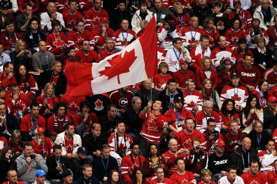 VANCOUVER, BC - FEBRUARY 28:  Canada fans cheer on their team during  the ice hockey men's gold medal game between USA and Canada on day 17 of the Vancouver 2010 Winter Olympics at Canada Hockey Place on February 28, 2010 in Vancouver, Canada.  (Photo by Jamie Squire/Getty Images) Photo: Jamie Squire, Getty Images / 2010 Getty Images
