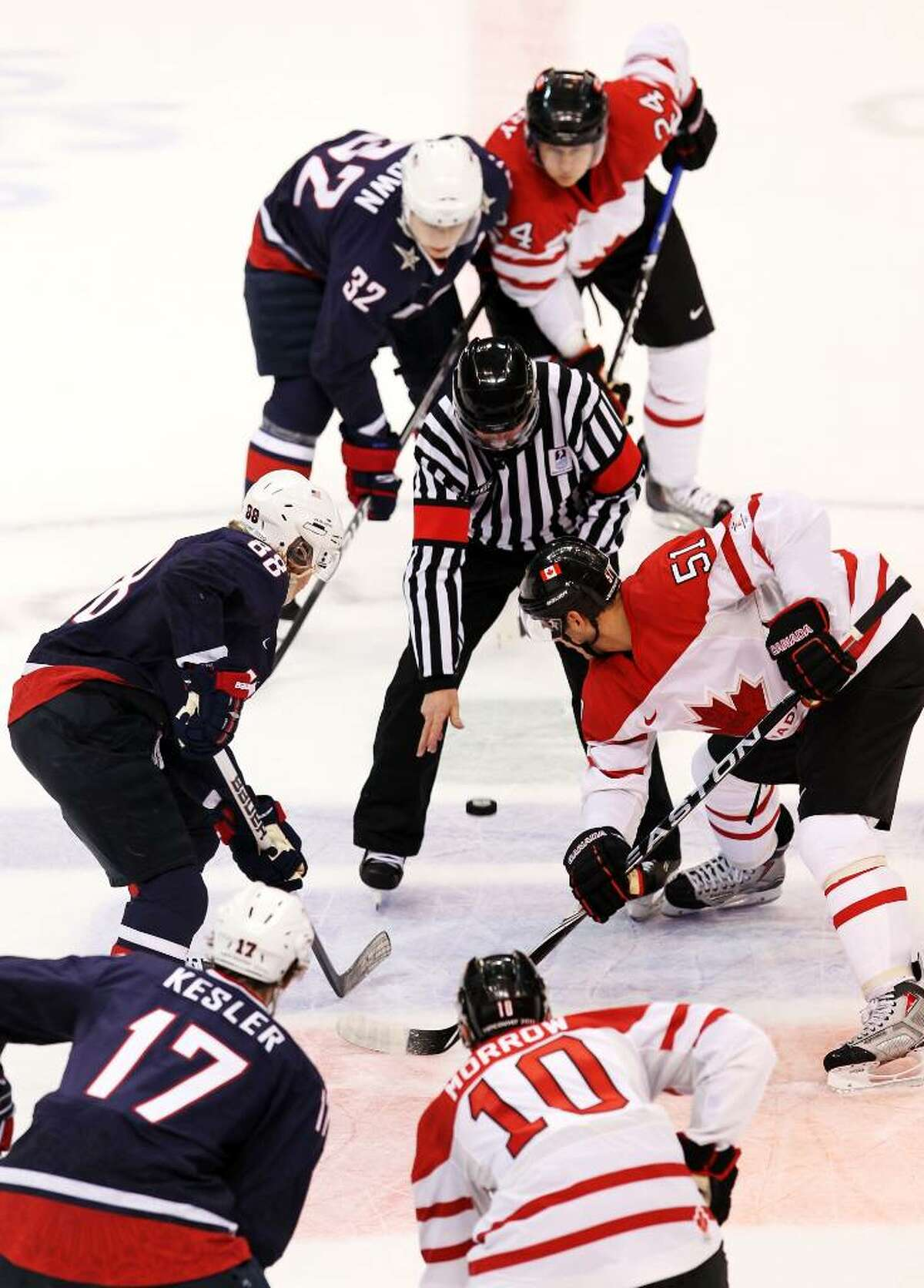 VANCOUVER, BC - FEBRUARY 28: The Official drops the puck at a face off during the ice hockey men's gold medal game between USA and Canada on day 17 of the Vancouver 2010 Winter Olympics at Canada Hockey Place on February 28, 2010 in Vancouver, Canada. (Photo by Jamie Squire/Getty Images)