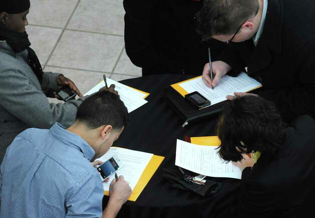 Potential employees fill out applications during a Nano Job Fair at CNSE?s Albany NanoTech Complex on Saturday Feb. 2, 2013 in Albany, N.Y. .(Michael P. Farrell/Times Union) Photo: Michael P. Farrell / 10021014A
