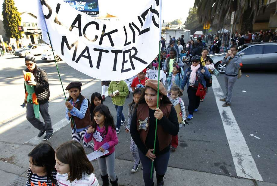 Children and their parents march to the Farmers Market near Lake Merritt during a Black Lives Matter story time action in Oakland, Calif. on Saturday, Jan 3, 2015. The Colorful Mamas of the 99 Percent organized the event to engage children in current social and political issues. Photo: Paul Chinn, The Chronicle