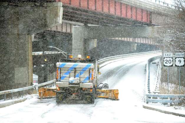 A snow plow turns up the ramp from North Pearl Street toward Rensselaer on Saturday, Jan. 3, 2015, in Albany, N.Y. (Cindy Schultz / Times Union) Photo: Cindy Schultz