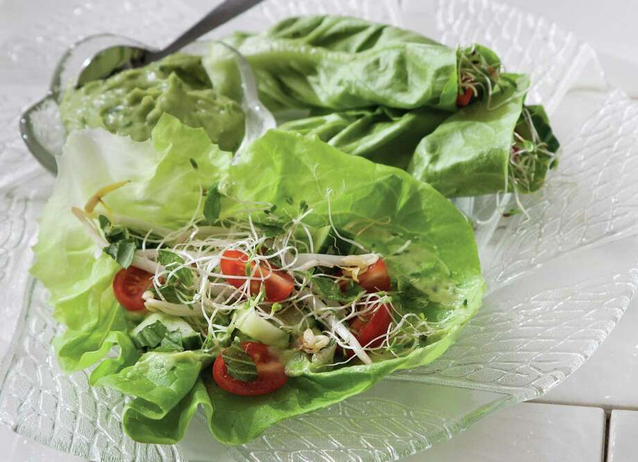 """Lettuce Wraps is among the multitude of recipes in """"Vegan Vitality,"""" most of which feature ingredients you already are using in your meal preparation. Photo: John C. Watson /Skyhorse Publishing"""
