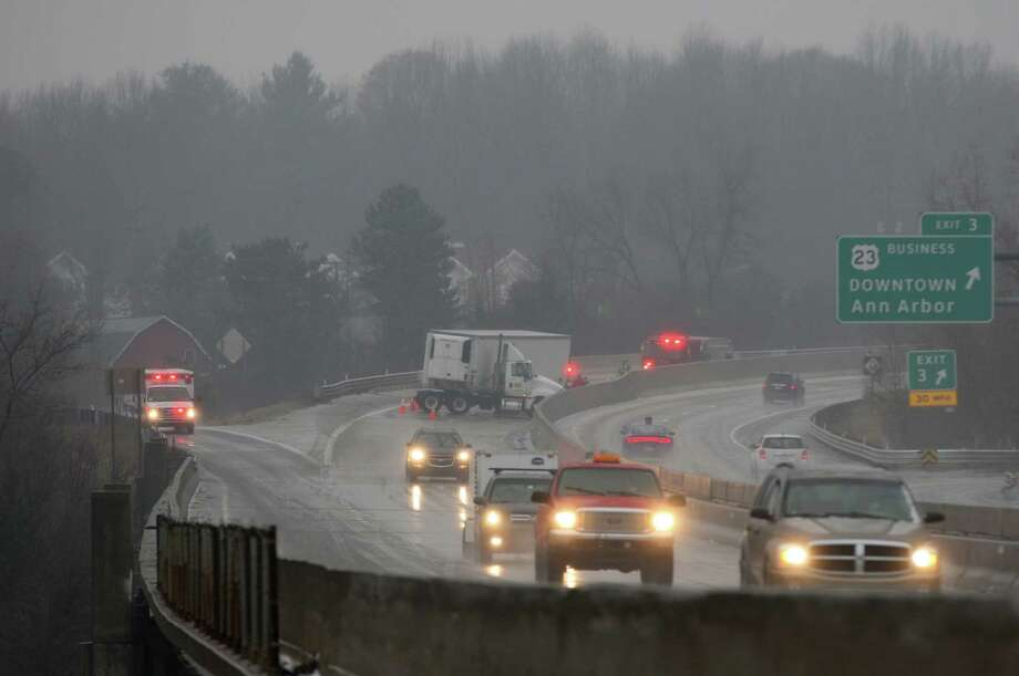 A truck is stalled on M14 in Ann Arbor, Mich., during a rainstorm that made for bad road conditions on Saturday, Jan. 3, 2014. (AP Photo/The Ann Arbor News, Patrick Record) Photo: Patrick Record, MBI / The Ann Arbor News