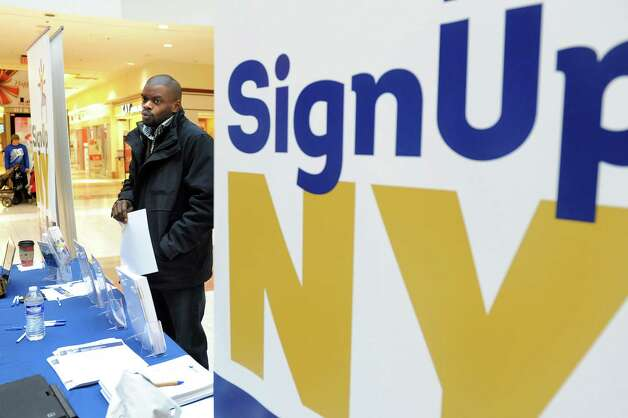 Chuks Azi of Troy inquires about information at the Affordable Health Care Insurance booth on Saturday, Jan. 3, 2015, at Colonie Center in Colonie, N.Y. (Cindy Schultz / Times Union) Photo: Cindy Schultz / 00030047A