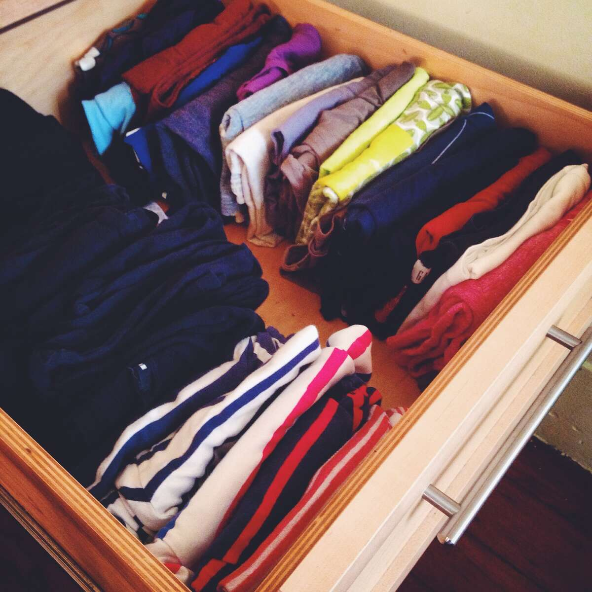 The Konmari T-shirt filing system works: more room, no wrinkles and I can see everything.