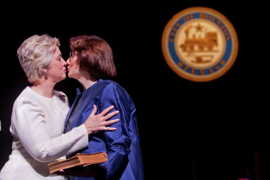 Houston Mayor Annise Parker kisses her partner Kathy Hubbard after Parker was sworn in for her third term as mayor during the City of Houston Inauguration Ceremony for Mayor Parker, City Controller Ronald Green and the 16-member Houston City Council at Wortham Theater Center Thursday, Jan. 2, 2014, in Houston. Photo: Johnny Hanson, Houston Chronicle / Houston Chronicle