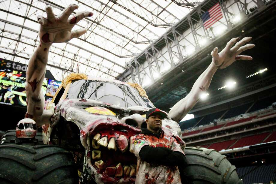 "Bari Musawwir driver of the Zombie monster truck poses for portraits during the Monster Jam Pit Party at NGR Stadium. The mister trucks will be performing the ""Baddest"" Monster Jam show in Houston, January 3, 2015. Saturday, Jan. 3, 2015. Photo: Marie D. De Jesus, Houston Chronicle / © 2015 Houston Chronicle"