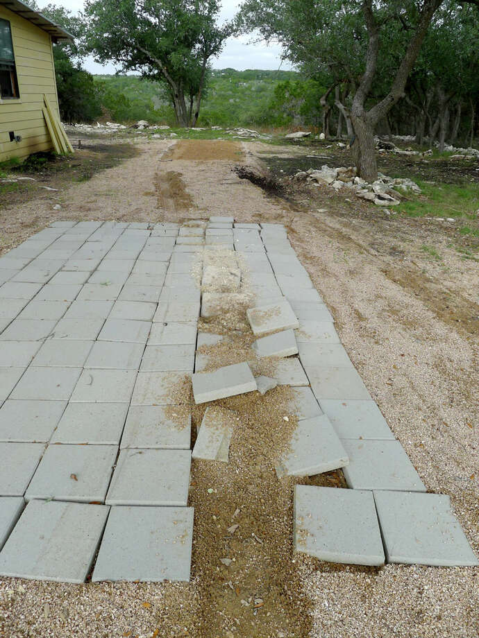 The paver driveway leading up to the tiny house of Casey Friday was destroyed when thieves towed the home away while he and his wife were gone. Photo: Photos Courtesy Of Casey Friday