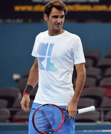 Switzerland's Roger Federer takes part in a practice session ahead of the Brisbane International tennis tournament at the Patrick Rafter Arena in Brisbane on January 3, 2015. AFP PHOTO / Saeed KHAN -- IMAGE RESTRICTED TO EDITORIAL USE - STRICTLY NO COMMERCIAL USESAEED KHAN/AFP/Getty Images Photo: SAEED KHAN / AFP