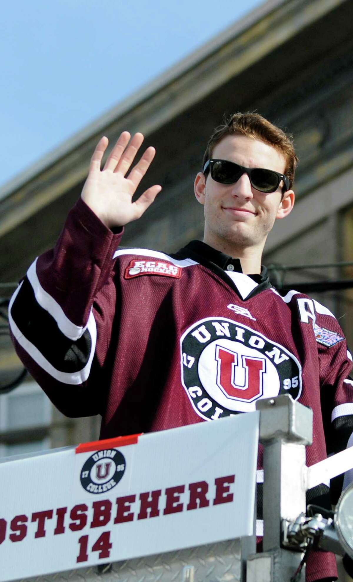 Union's Shayne Gostisbehere waves to fans from a fire truck during a parade to honor the NCAA Hockey Champions on Thursday, April 17, 2014, in Schenectady, N.Y. (Cindy Schultz / Times Union)