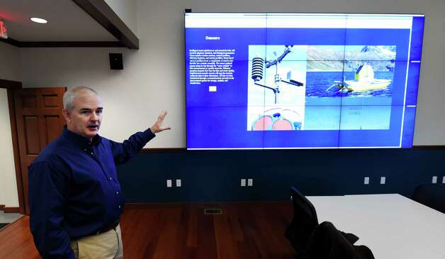Rick Relyea, director of the Jefferson Project, demonstrates a 9 screen display which shows a model of what the real-time information on new high-tech monitoring center that is connected to a supercomputer to analyze data about the state of Lake George Monday morning, Nov. 17, 2014, in Lake George, N.Y.  This is part of the massive Jefferson Project involving RPI, IBM and the Fund for Lake George. (Skip Dickstein/Times Union) Photo: SKIP DICKSTEIN / 00029496A