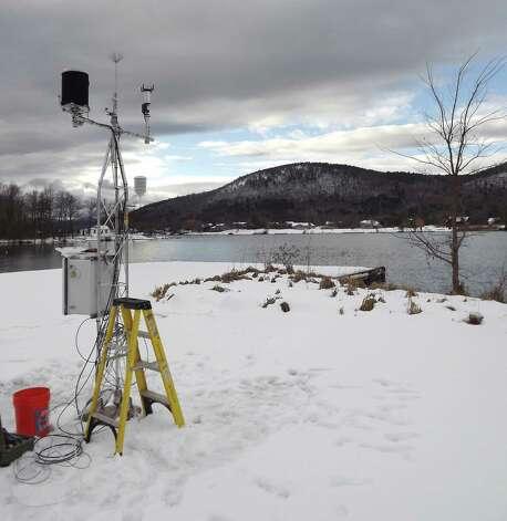 A weather sensor station is installed near Lake George Thursday, Dec. 18, 2014, in Ticonderoga, N.Y. (Brian Nearing/Times Union) Photo: WW / 00029923A