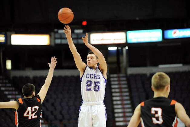 Catholic Central's Anthony Mack, center, shoots for three points during their basketball game against Mohonasen on Saturday, Jan. 3, 2015, at Times Union Center in Albany, N.Y. (Cindy Schultz / Times Union) Photo: Cindy Schultz / 00030045A